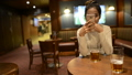 Portrait of young beautiful Asian tourist woman relaxing at the pub indoors 71663988