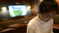 Portrait of young beautiful Asian tourist woman relaxing at the pub indoors 71663993