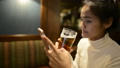 Portrait of young beautiful Asian tourist woman relaxing at the pub indoors 71663998