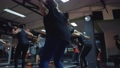 sportive woman doing squats exercises workout group 71742086