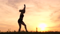 Young girl sportswoman doing the wheel at sunset in slow motion. 71869163