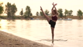 Dance at sunset of the young blonde girl in slow motion. 71872719