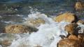Waves beating against stones. Azure blue sea. Water splash 72204257