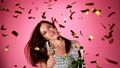 Super Slow Motion of Excited Brunette Woman with falling confetti dancing and jumping, having fun. 72222880