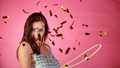 Super Slow Motion of Excited Brunette Woman with falling confetti dancing and jumping, having fun. 72222881