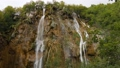Streams of water fall from sharp rock in green forest. Cloudy day in Croatia 72236844