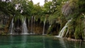 Waterfalls of world-famous Plitvice Lakes. Green picturesque lakeside and transparent water 72236845