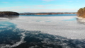 Fly over a freezing lake on a clear day. 72258251