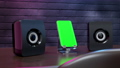 Smartphone and Speaker on wood desk and magenta and blue light. Animation Phone mock-up with green screen for your text. 3D Render. 72288692