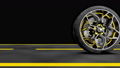 Alloy wheel with modern Brake Disc and Calliper carbon fiber. Animation on road. 3D render. 72288694