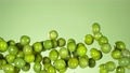 Super Slow Motion Shot of Flying Fresh Green Olives on Light Green Gradient Background at 1000 fps. 72330687