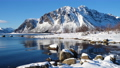 winter nothern mountains and snowed ocean shore at the bright sunny day 72332951