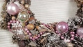 Woman florist makes new year wreaths. 72336664
