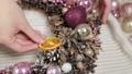 Woman florist makes new year wreaths. 72336665