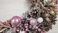 Woman florist makes new year wreaths. 72336670