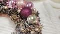Woman florist makes new year wreaths. 72336673