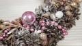 Woman florist makes new year wreaths. 72336675