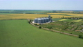 modern grain silos elevator at the field of golden wheat aerial view 72360594