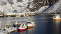 beautiful norwegian winter landscape with the multicolored rorbu and moored fishing ships at the bay of Lofoten archipelago, nothern Norway 72360684