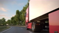 Semi-trailer truck passes the camera driving along a countryside road 72387598