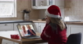 Caucasian woman wearing santa hat on laptop video chat during christmas at home 72615288