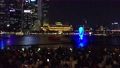 People Enjoying Laser Show at Marina Bay of Singapore, one of the most popular tourists attraction in city at Night 72905044
