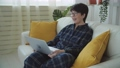 Remote work concept. Mature woman in pajamas working at home with notebook computer 72982011