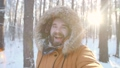 Winter tourism and hiking concept. Young bearded man taking selfie in the forest 72983569