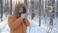 Winter tourism and hiking concept. Beard man with hot drink in winter forest 72983570