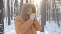 Winter tourism and hiking concept. Beard man with hot drink in winter forest 72984568
