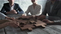 Business people and wooden puzzle 73011331