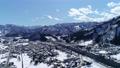 ドローンで撮影した冬の越後湯沢駅上空の絵 73023627