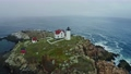Aerial view of Nubble lighthouse in York, ME in fog 73095234