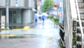 Rainy Tokyo pedestrian crossing People walking with an umbrella Out focus 73140939