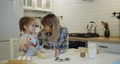 Young mother and daughter having fun baking cookies in the kitchen together 73166804