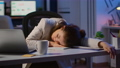 Exhausted overload business woman falling asleep on desk 73199576
