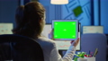 Businesswoman holding tablet with green screen monitor 73199585
