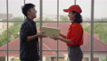young Asian pizzeria food delivery worker is coming to deliver food to her workplace. 73240035