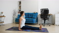 Young woman practicing yoga at home, sits in inversion position 73244940