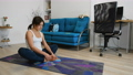 Young woman practicing yoga at home 73260749