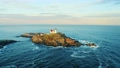 Aerial view of Nubble lighthouse in York, ME at sunset 73272167