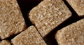 The brown cane sugar cubes rotate slowly. 73285643