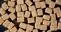 The brown cane sugar cubes rotate slowly. 73285658