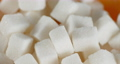 The white sugar cubes rotate slowly.  73285663