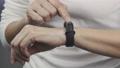 Woman using her smartwatch touchscreen 73294766