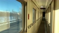 In the corridor of the compartment car of the train in motion, flashing winter landscape outside the 73358568
