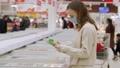 Woman buying frozen food in supermarket. 73361671