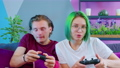 A couple in pajamas playing a game console 73372119