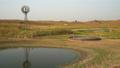 Calm fall morning in  in a prairie of Nebraska Sandhills with windmill 73527631