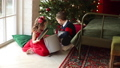 Happy children sister and brother open gifts 73570314